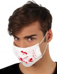 Valkoinen lääkärin maski veritahroilla