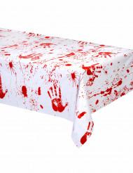 Pöytäliina täynnä verisiä kädenjälkiä