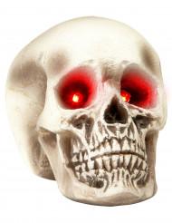 Pääkallokoriste punaisilla hohtavilla silmillä