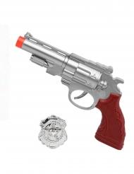 Hopeanvärinen pistooli sekä poliisin virkamerkki